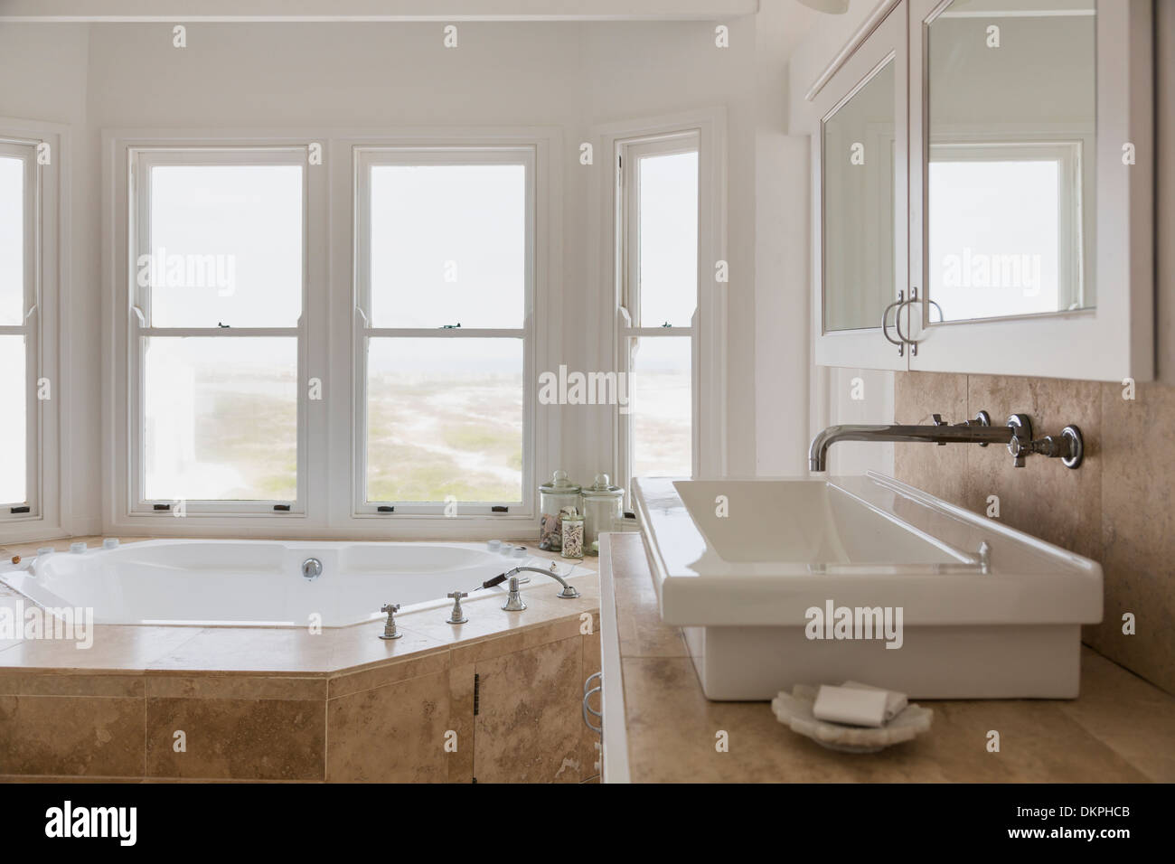 Sink and jacuzzi tub in luxury master bathroom Stock Photo: 63806187 ...