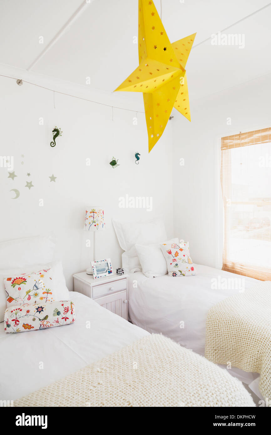 Yellow star lamp and wall decorations in childrens bedroom ...