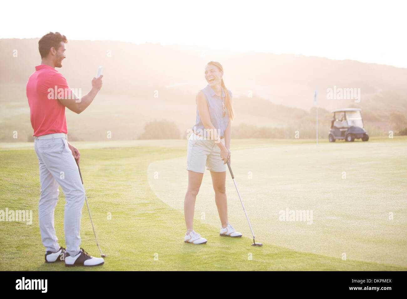 Couple playing golf - Stock Image