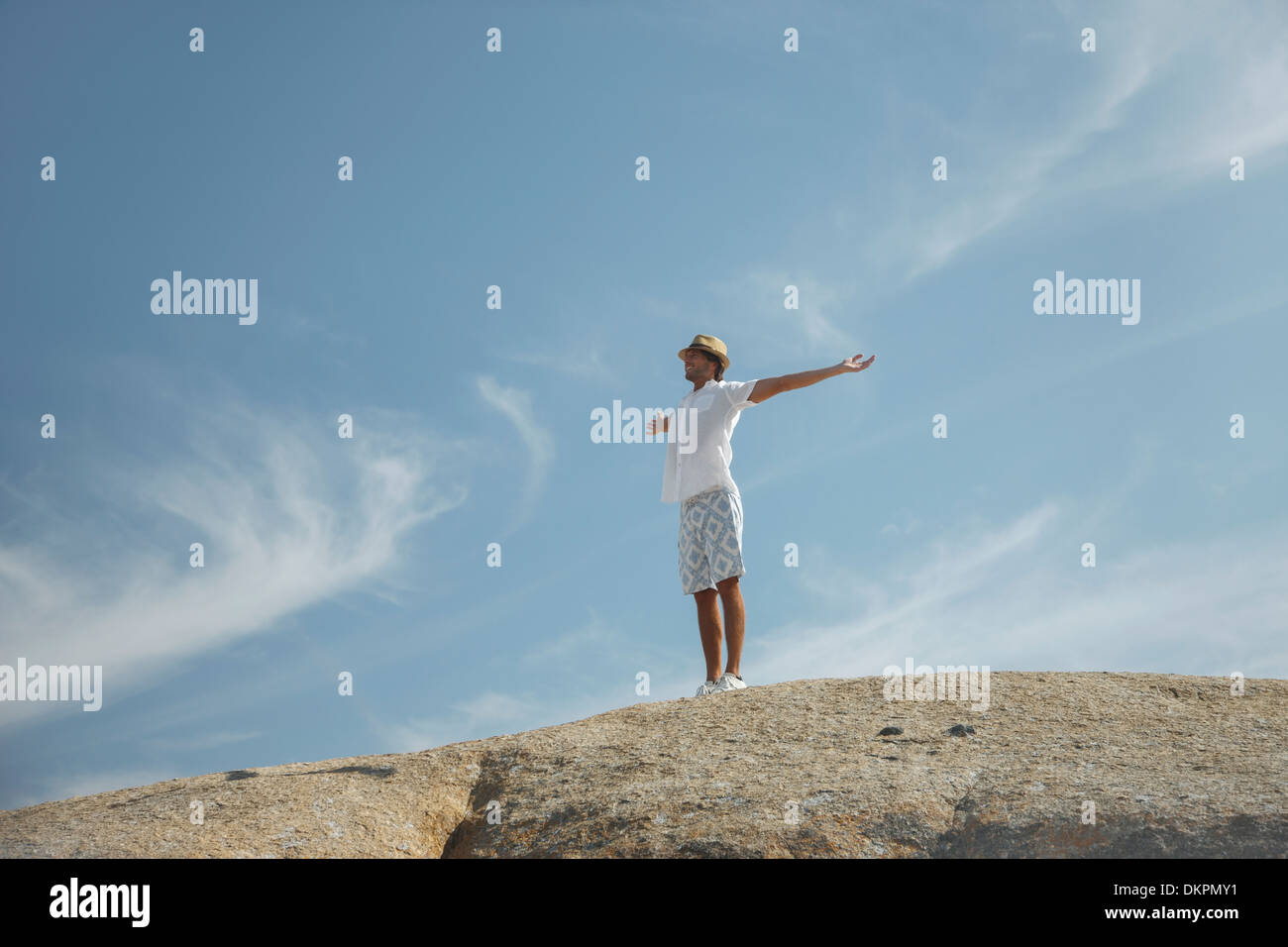 Man standing on rock formation - Stock Image