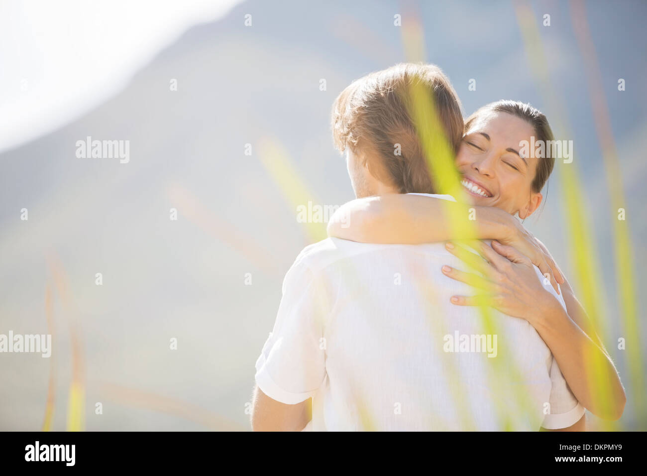 Couple hugging outdoors - Stock Image