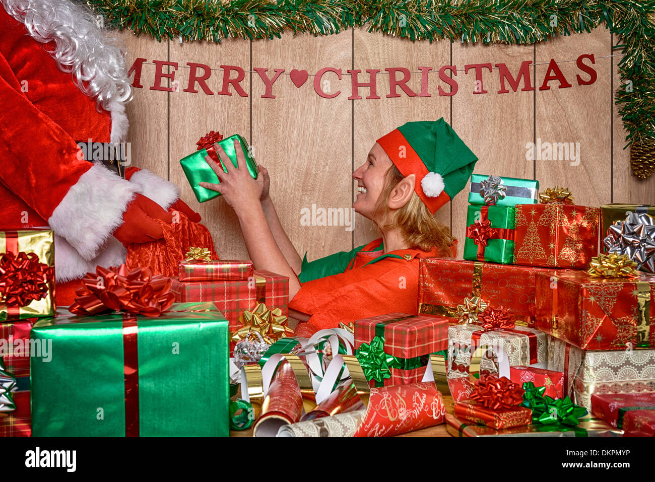 Santa\'s workshop in the North Pole and an Elf is helping Father ...
