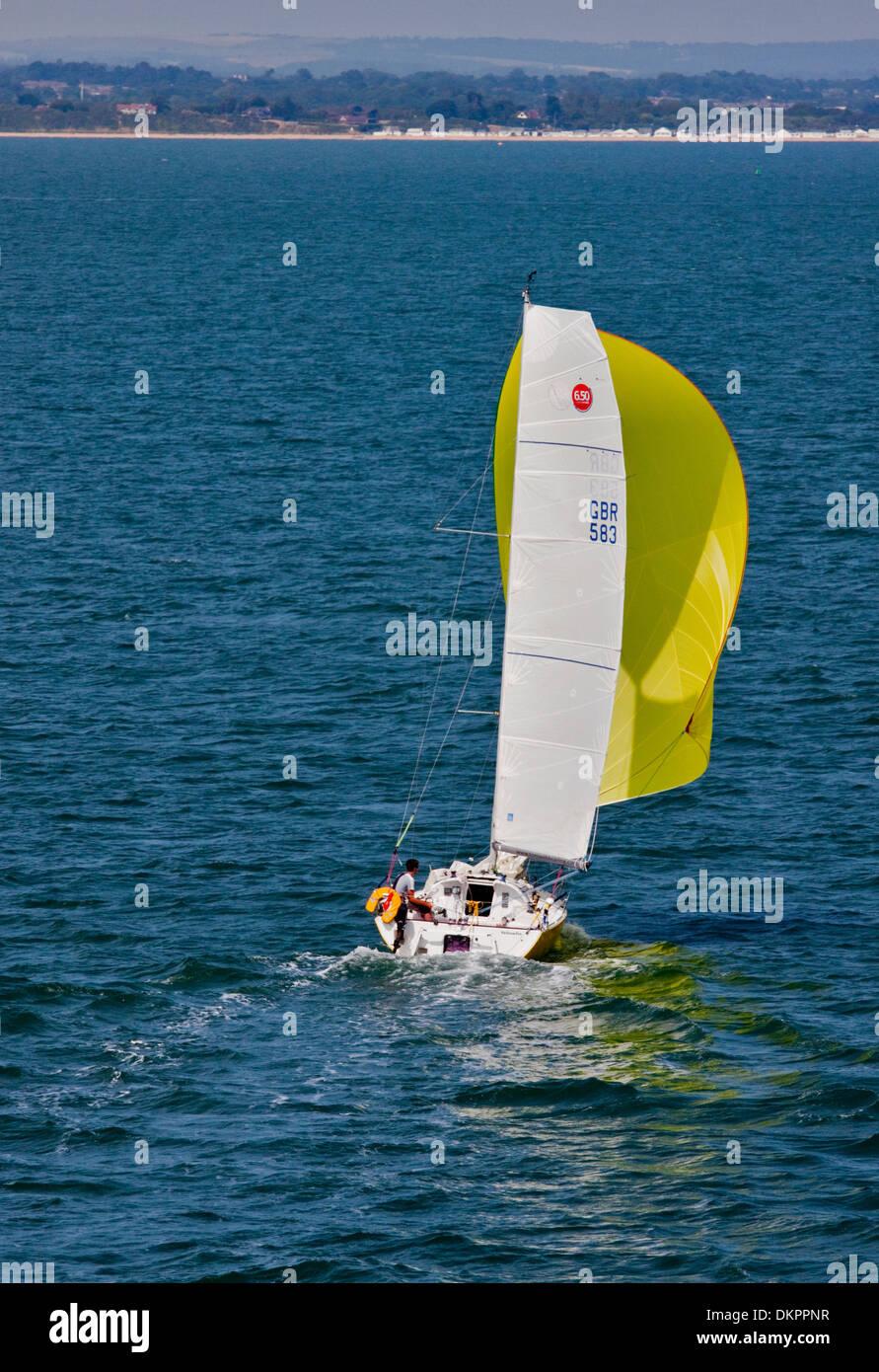 Man sailing Yacht sailing on Southampton Water, Hampshire, England - Stock Image