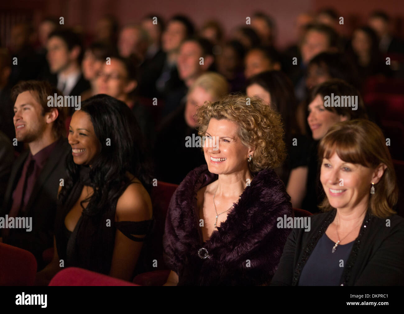 Smiling theater audience - Stock Image