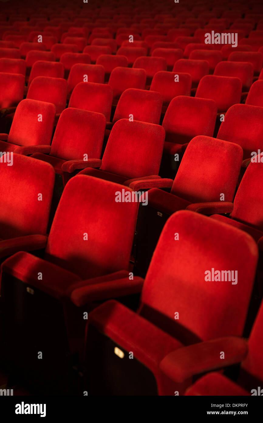Empty seats in theater auditorium - Stock Image