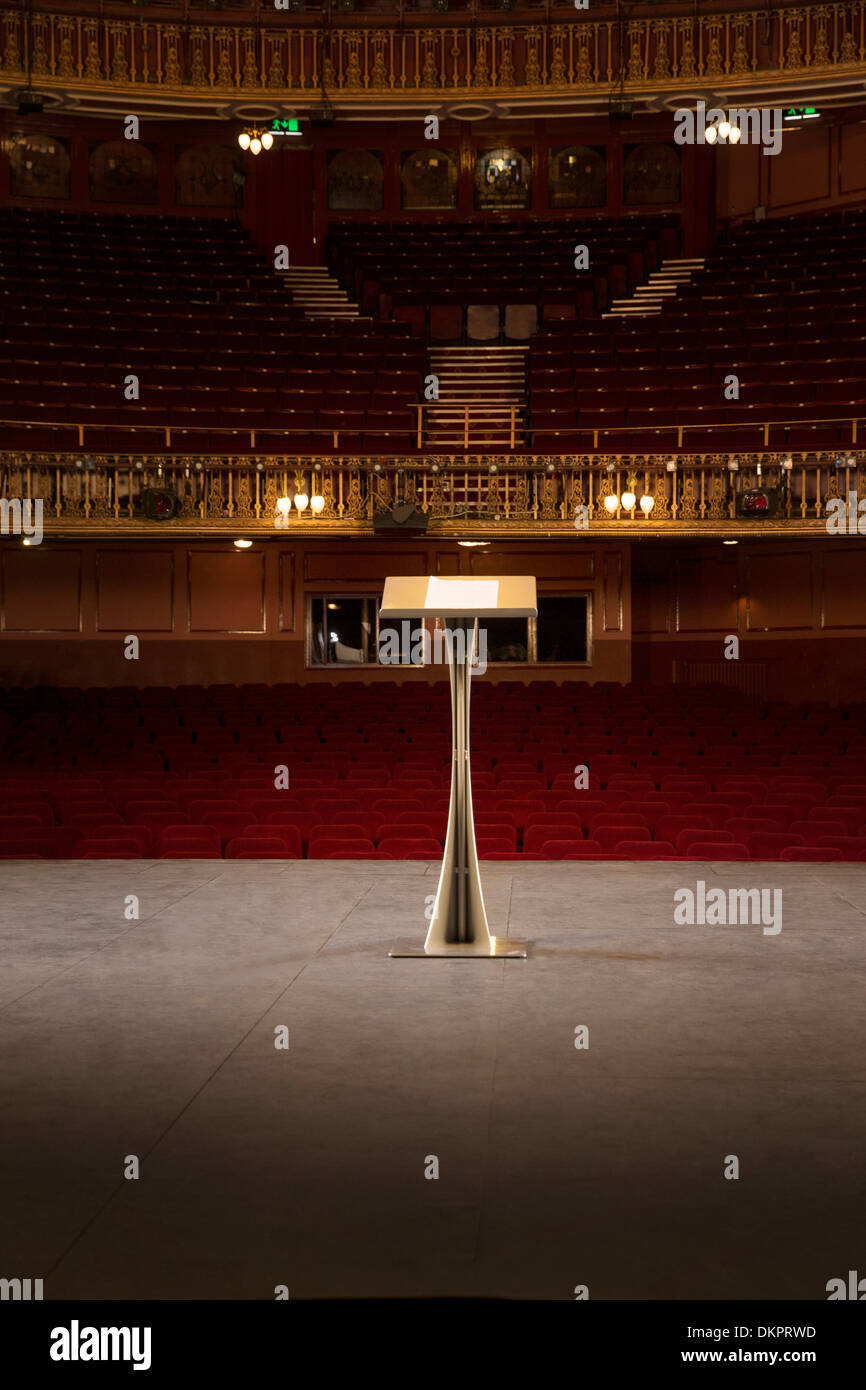 Podium on stage in empty theater - Stock Image
