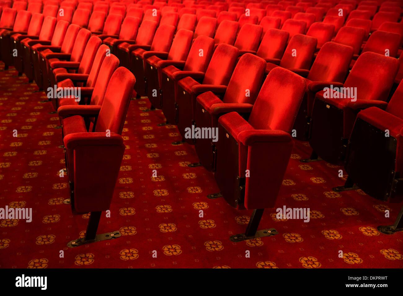 Seats in empty theater auditorium - Stock Image
