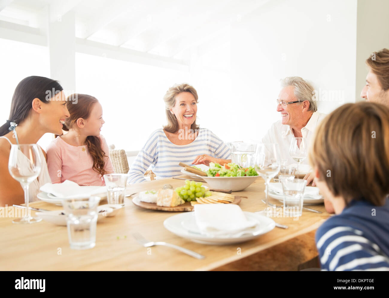 Multi-generation family eating together at table - Stock Image