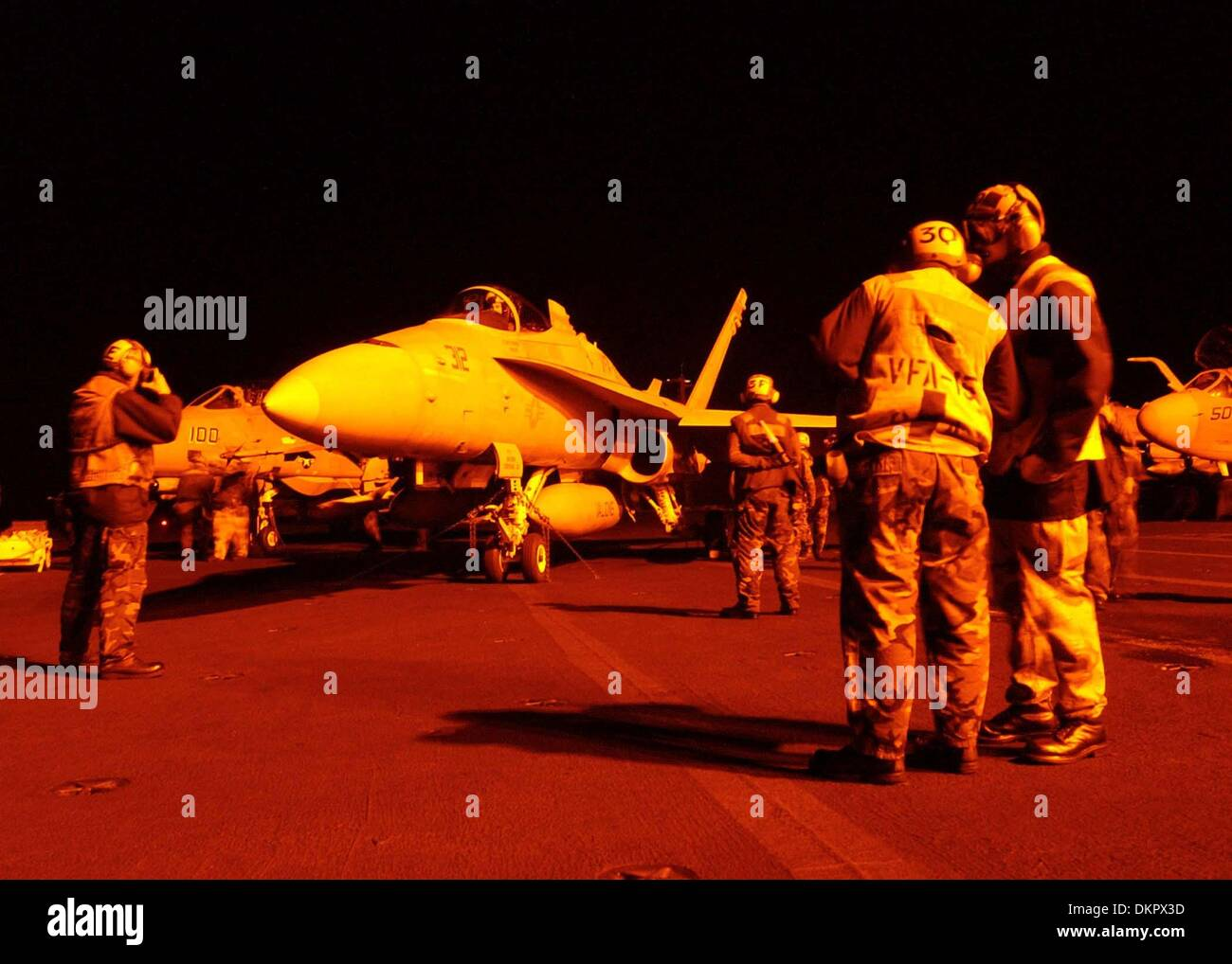 Nov. 23, 2002 - An F/A-18 Hornet from VFA-15 ''Valions'' waits to be guided into launch position on the flight deck of USS Theodore Roosevelt (CVN 71) during night flight operations on April 2, 2003. The Valions are part of Carrier Airwing Eight (CVW 8) currently deployed with the nuclear powered aircraft carrier in support of Operation Iraqi Freedom from the Mediterranean Sea. MCN - Stock Image