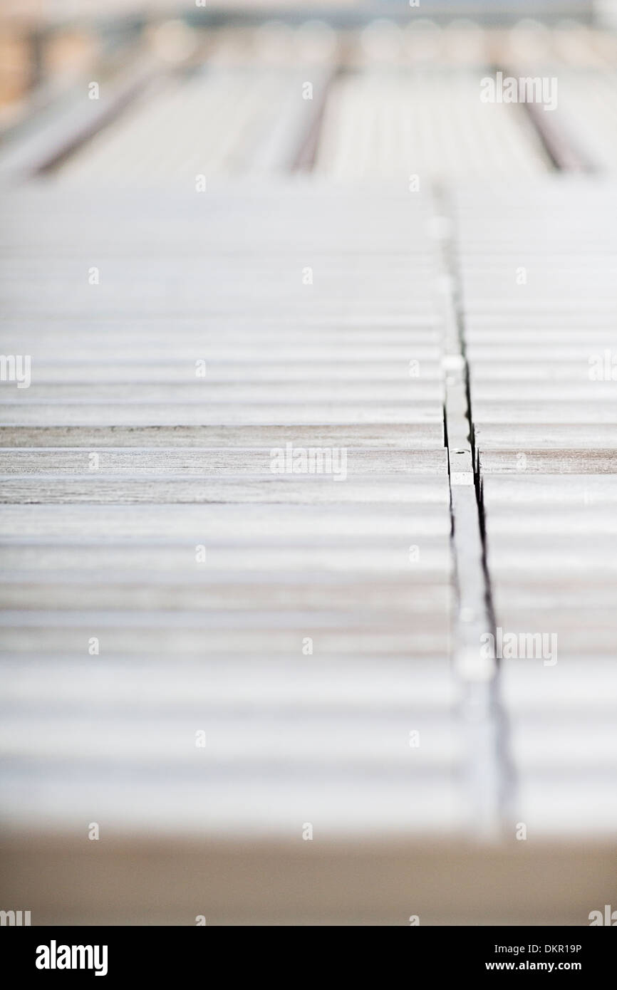 Close up of conveyor belt in factory - Stock Image