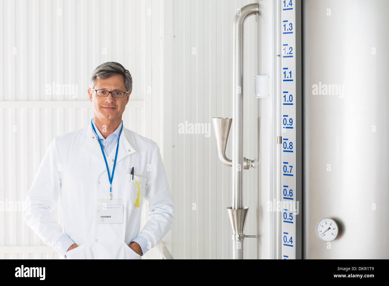 Scientist smiling in food processing plant Stock Photo