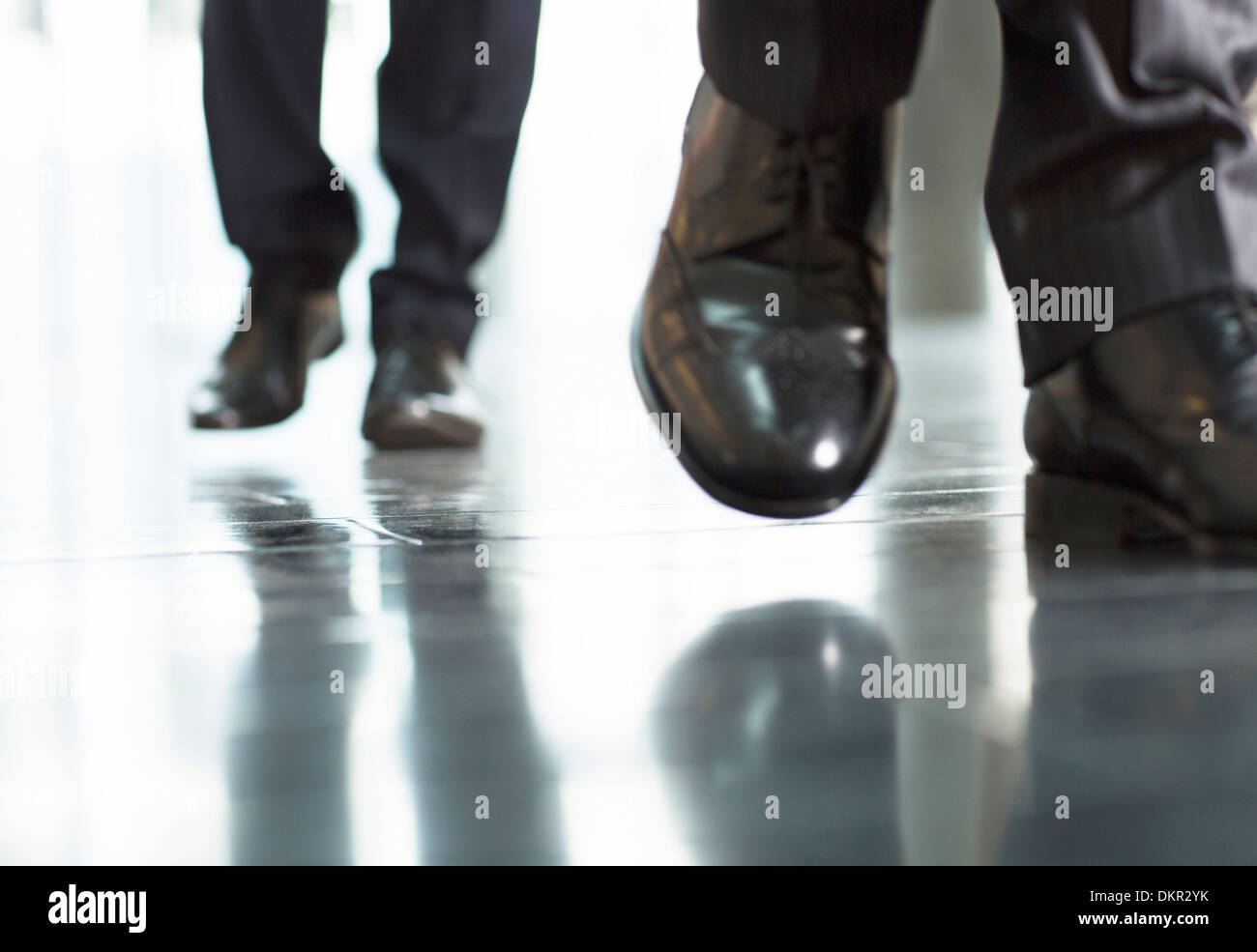 Close up of businessmens feet - Stock Image