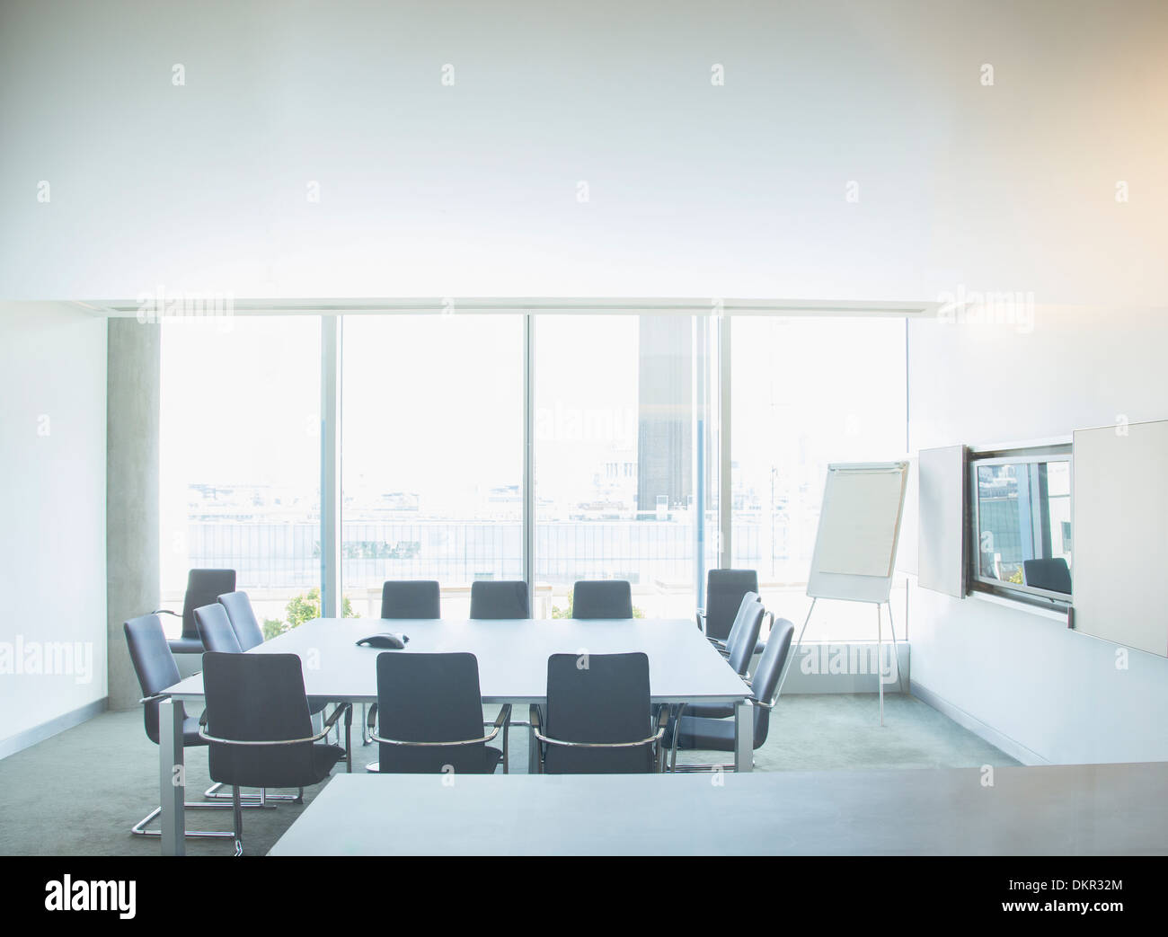 Empty meeting table in office - Stock Image