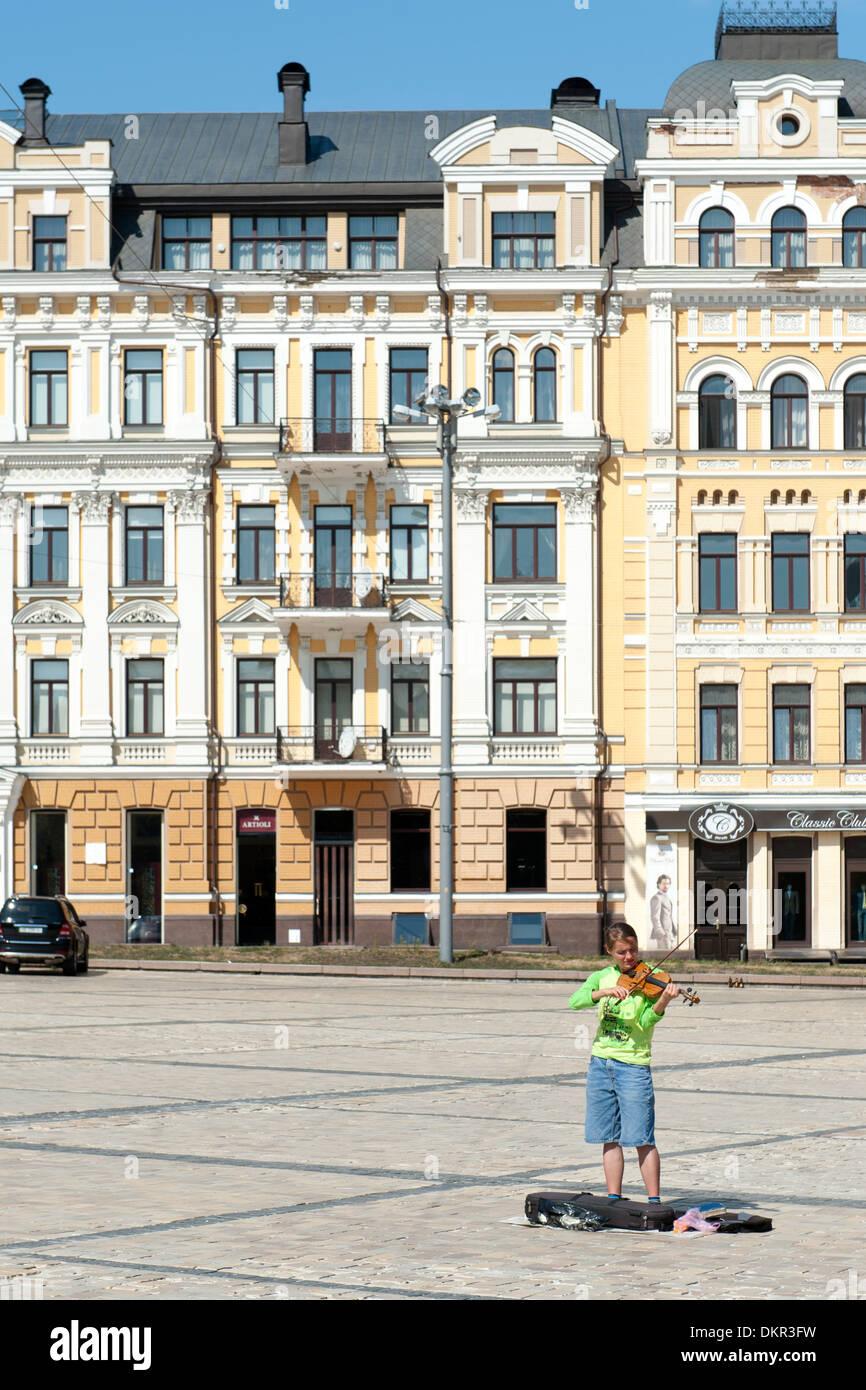 Busker playing a violin in St Sophia's Square in Kiev, the capital of Ukraine. - Stock Image