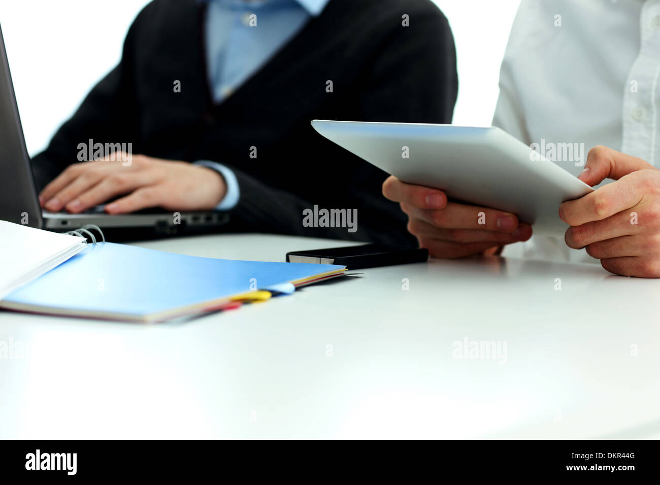 Businesspeople working in office at the table - Stock Image