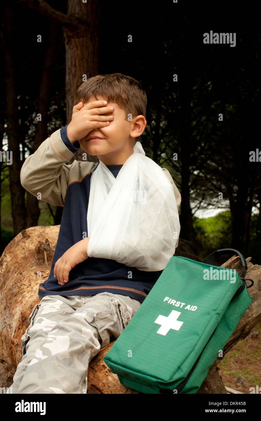 First Aid treatment given to a young boy in the forest