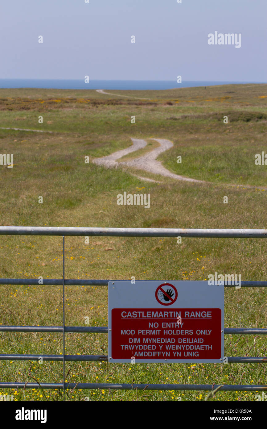 No Entry sign on gate at military firing range. Castlemartin Range. Pembrokeshire, Wales. June. Stock Photo