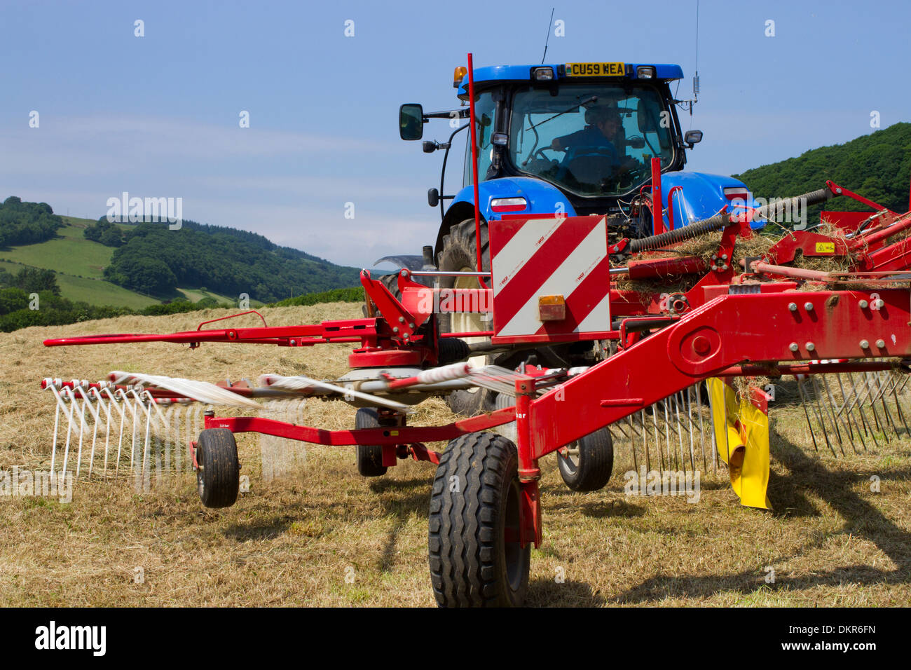 Contractor with a New Holland T7030 tractor and a SIP hay