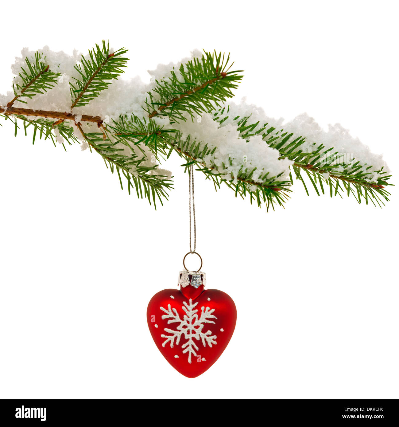 Red Heart Shaped Christmas Ornament Hanging From The Branch