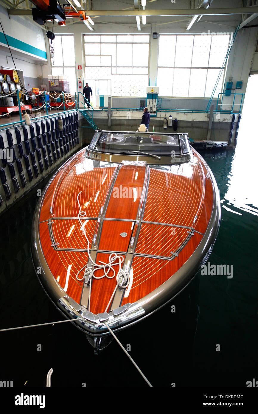 A Rivarama super yacht awaits testing at the Riva factory on Lake Iseo in Sarnico, Italy. - Stock Image