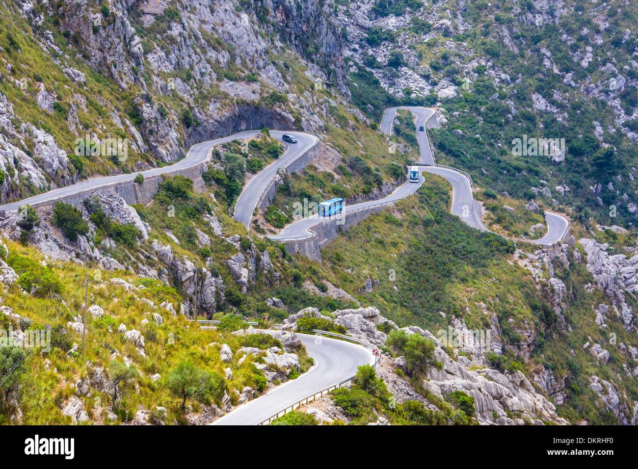 Drive Mallorca Balearics Sa Calobra bus curve island landscape mountain nature pass road rocks sightseeing Spain Europe steep - Stock Image