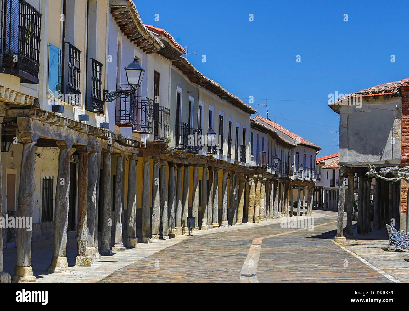 Ampudia Castilla Castile Leon Palencia Province architecture columns historical landscape old pueblo Spain Europe street - Stock Image