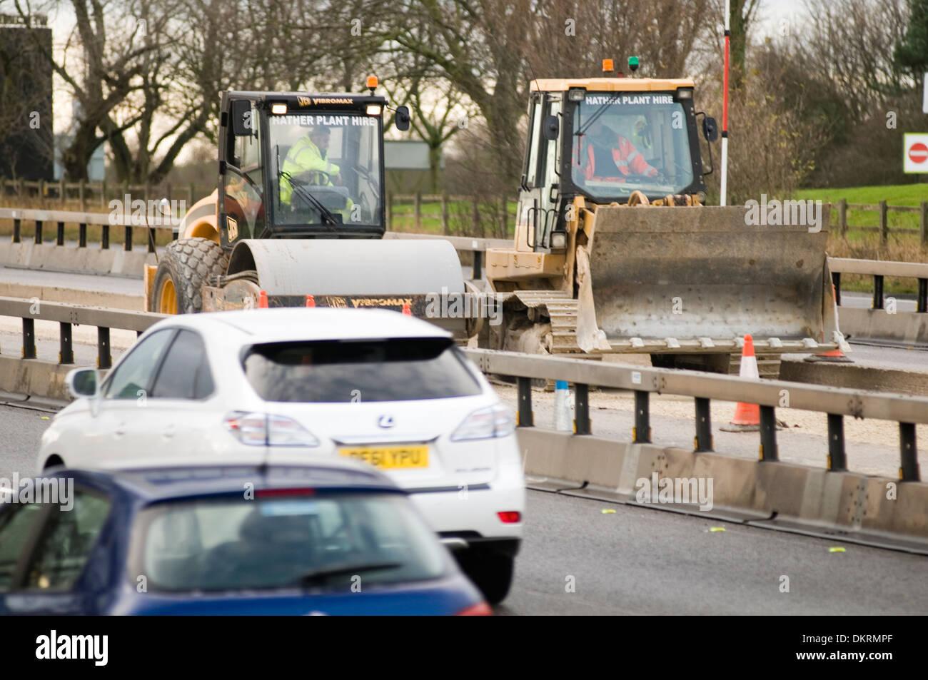 motorway roadworks road work works motorways m1 repair repairs repairing maintenance maintaining  heavy plant roller rollers dig - Stock Image