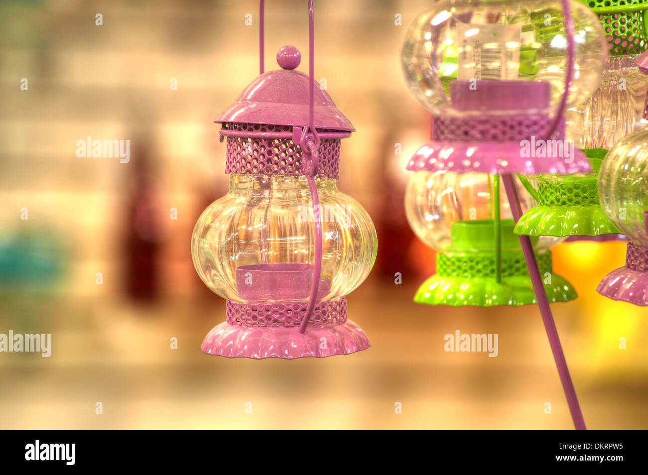 Decorative glass hanging lanterns and bottles - Stock Image