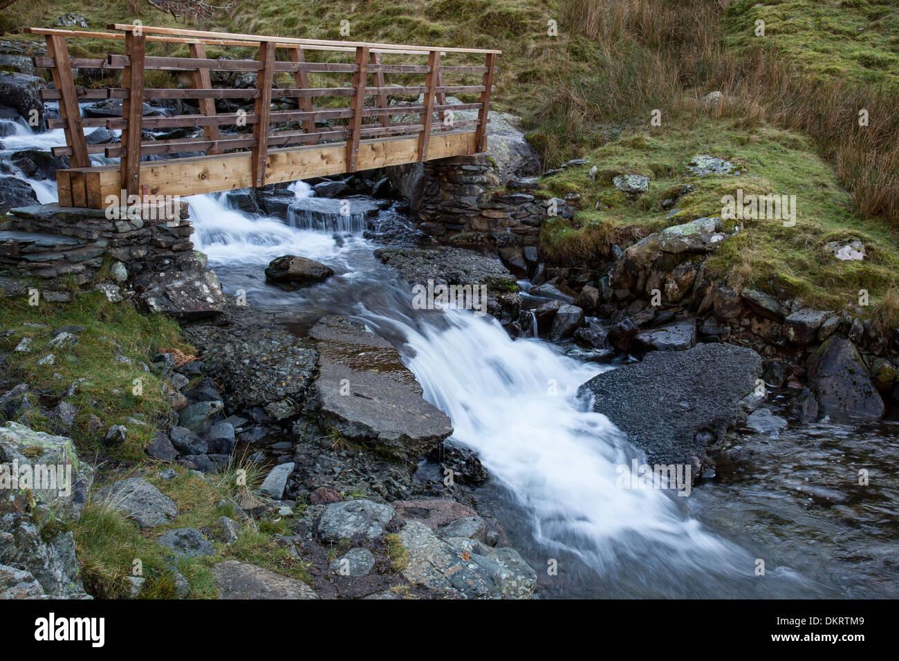 A footbridge across Hayeswater Gill, near Hartsop, Lake District, Cumbria - Stock Image