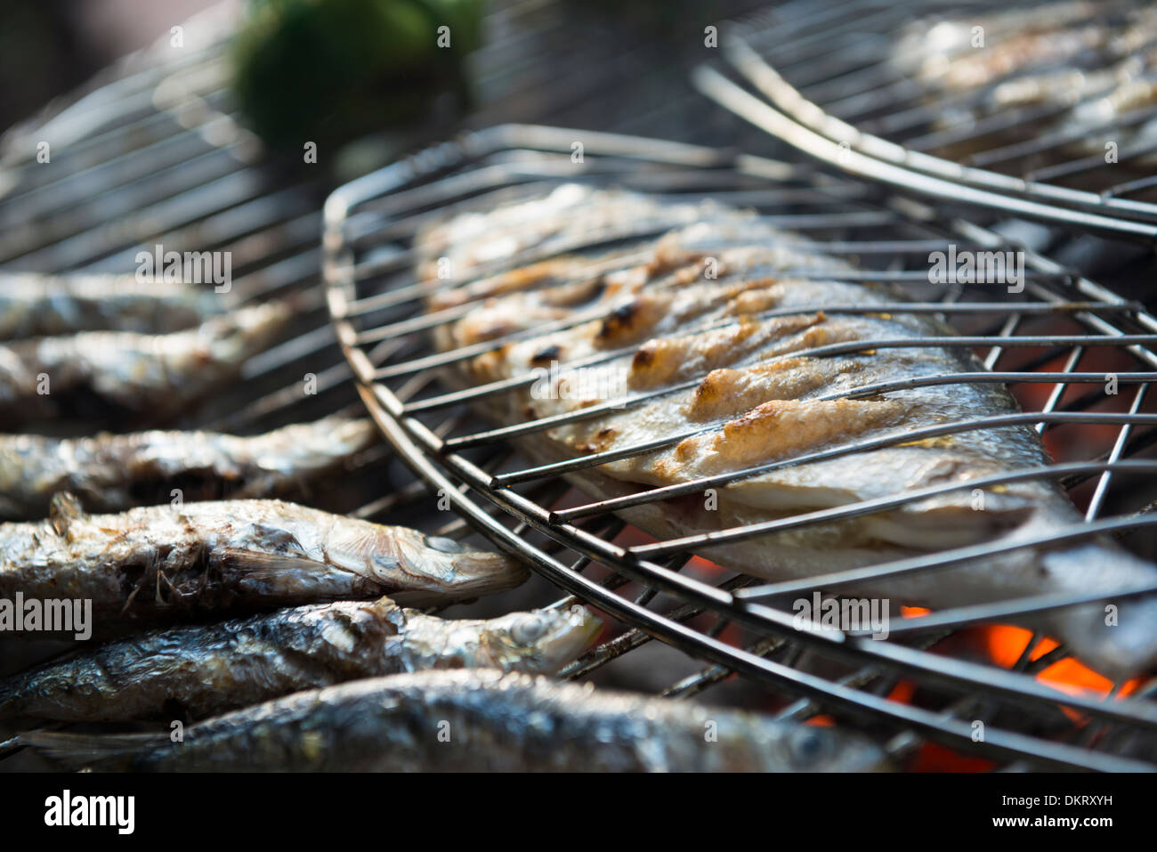 A healhty mediterranean BBQ consisting of fresh fish and vegetables - Stock Image