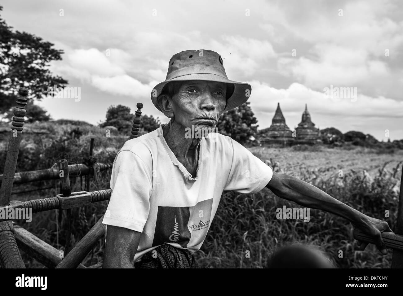 A farmer sits outside the temples in Bagan, Myanmar (Burma) - Stock Image