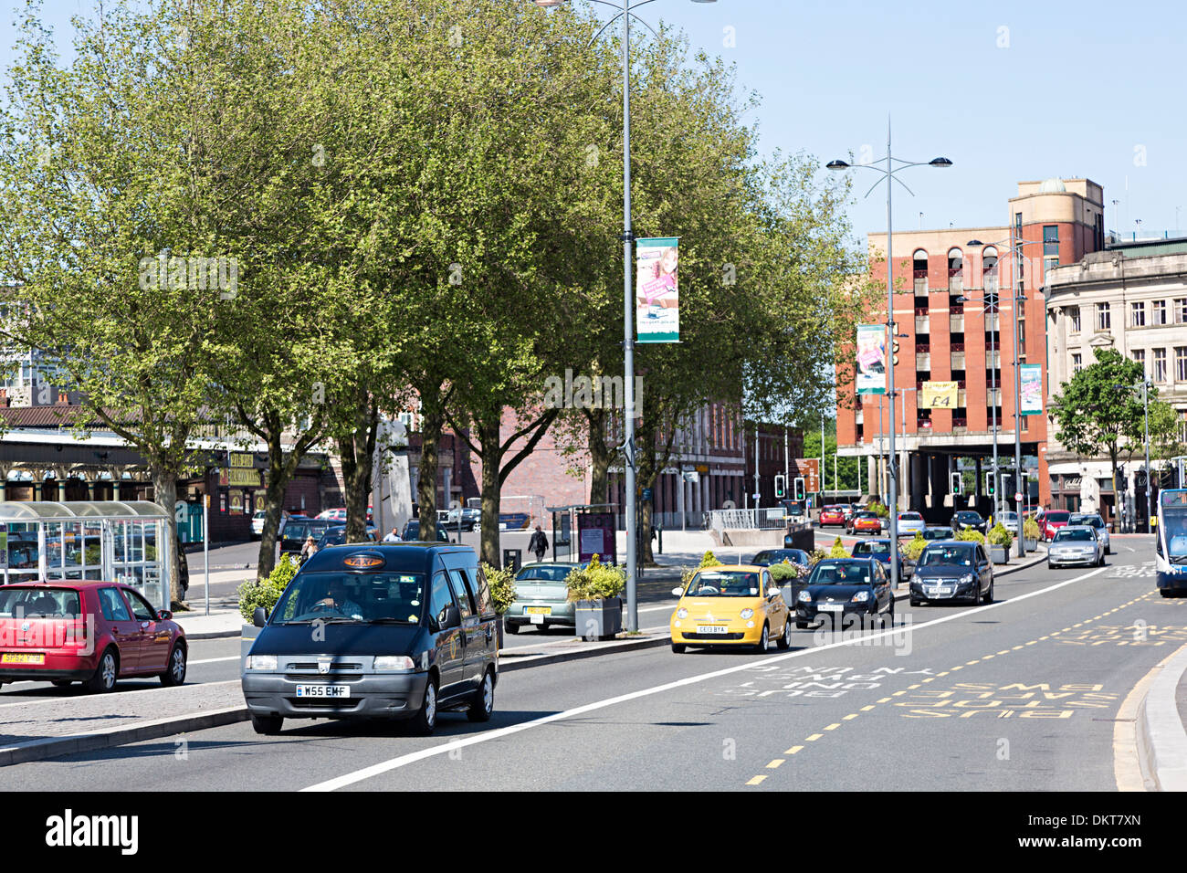 Taxi and cars driving through city centre, Newport, Gwent, Wales, UK - Stock Image