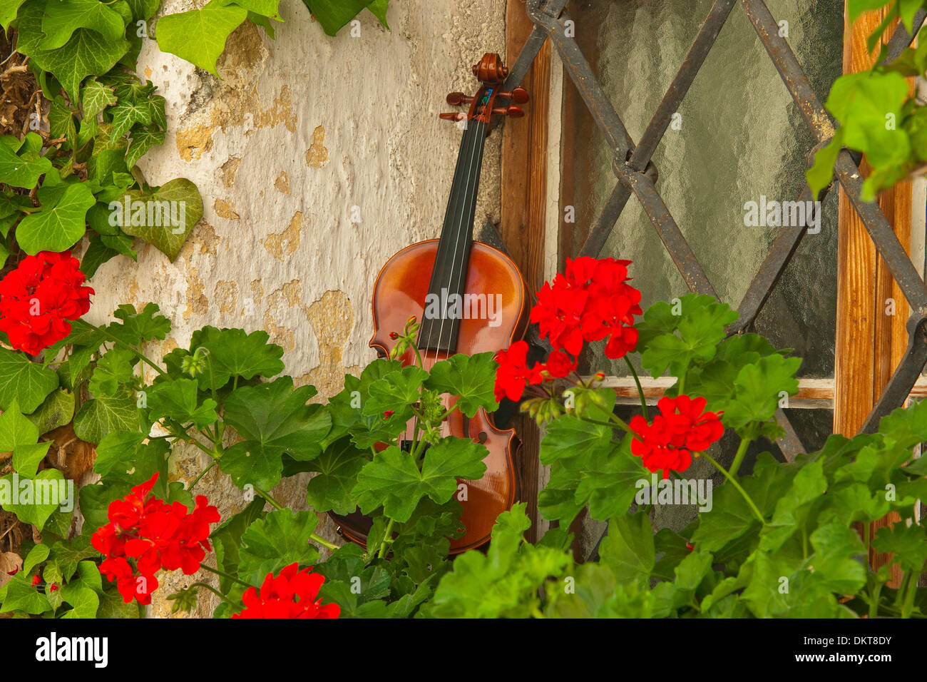 Bavaria Germany Europe Upper Bavaria Berchtesgaden country Anger Höglwörth Hoeglwoerth window geraniums window cross music - Stock Image