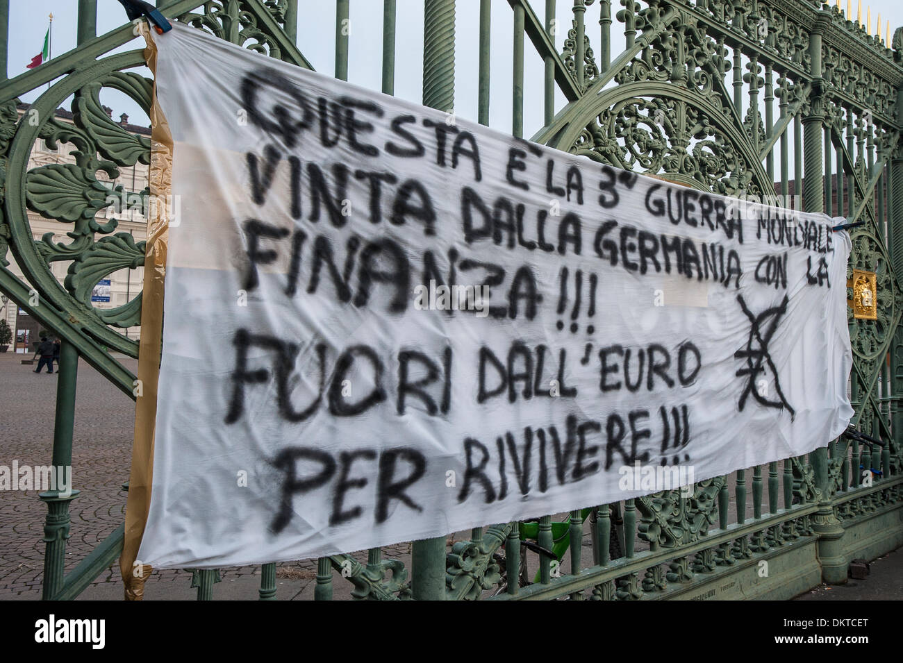 Italy Turin Piedmont 9th December 2013 demostration of ' Movimento dei forconi ' ( Pitchforks movement ) as interested the entire Italian peninsula, The most difficult in Turin. Piazza Castello the writing in the bed sheet says :'Is the Third world war, which was won by Germany with finance!!! Out of the Euro to revive ' Credit:  Realy Easy Star/Alamy Live News - Stock Image