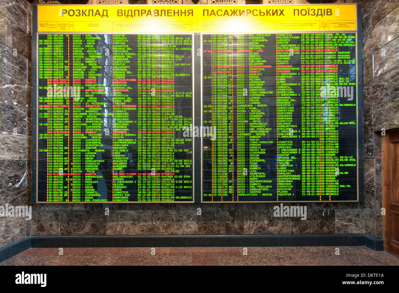 Train arrivals and departures board in the central train station in Kiev, the capital of Ukraine. - Stock Image