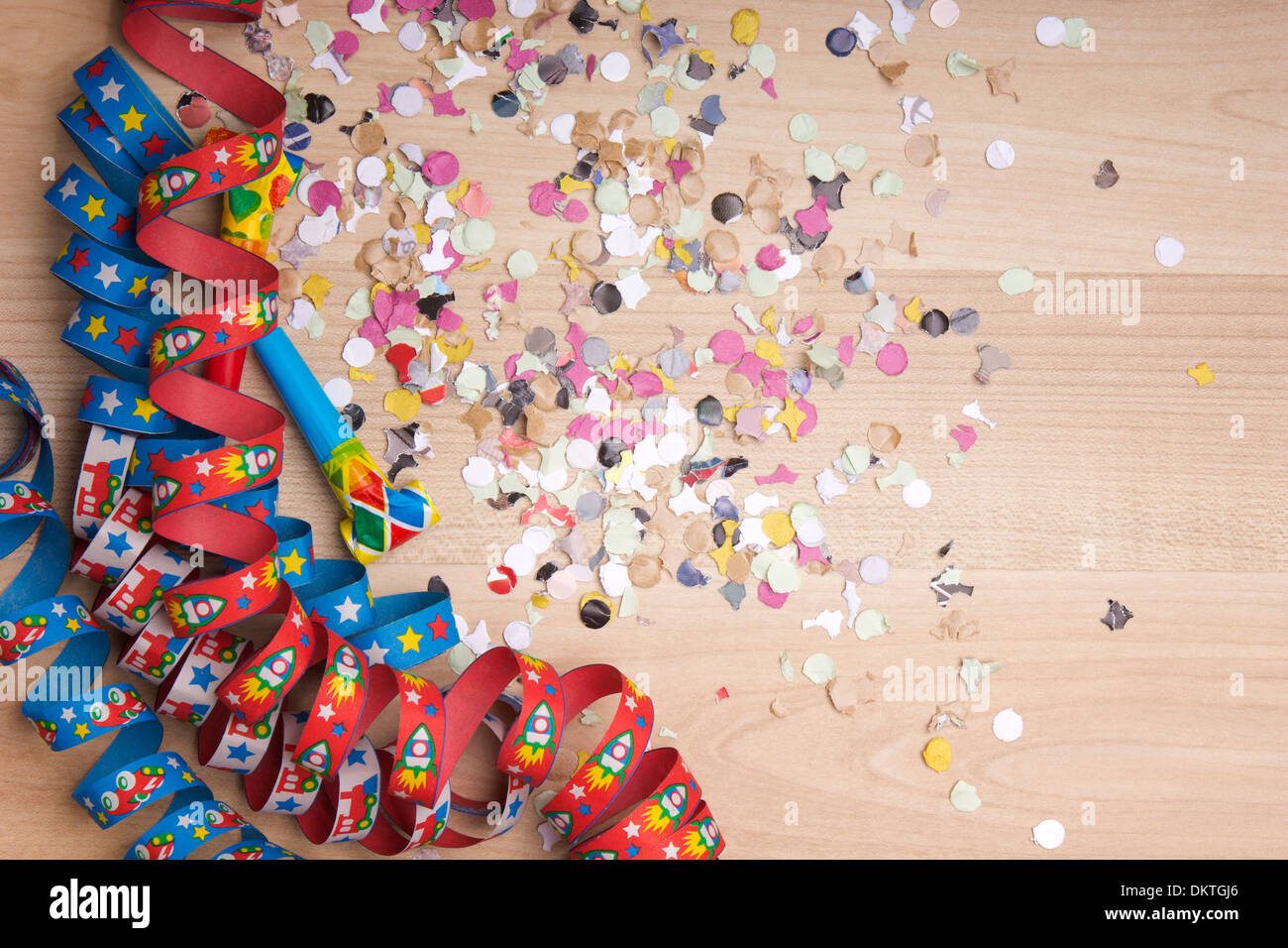 streamers and confetti as decoration for parties, sylvester with wooden background Stock Photo