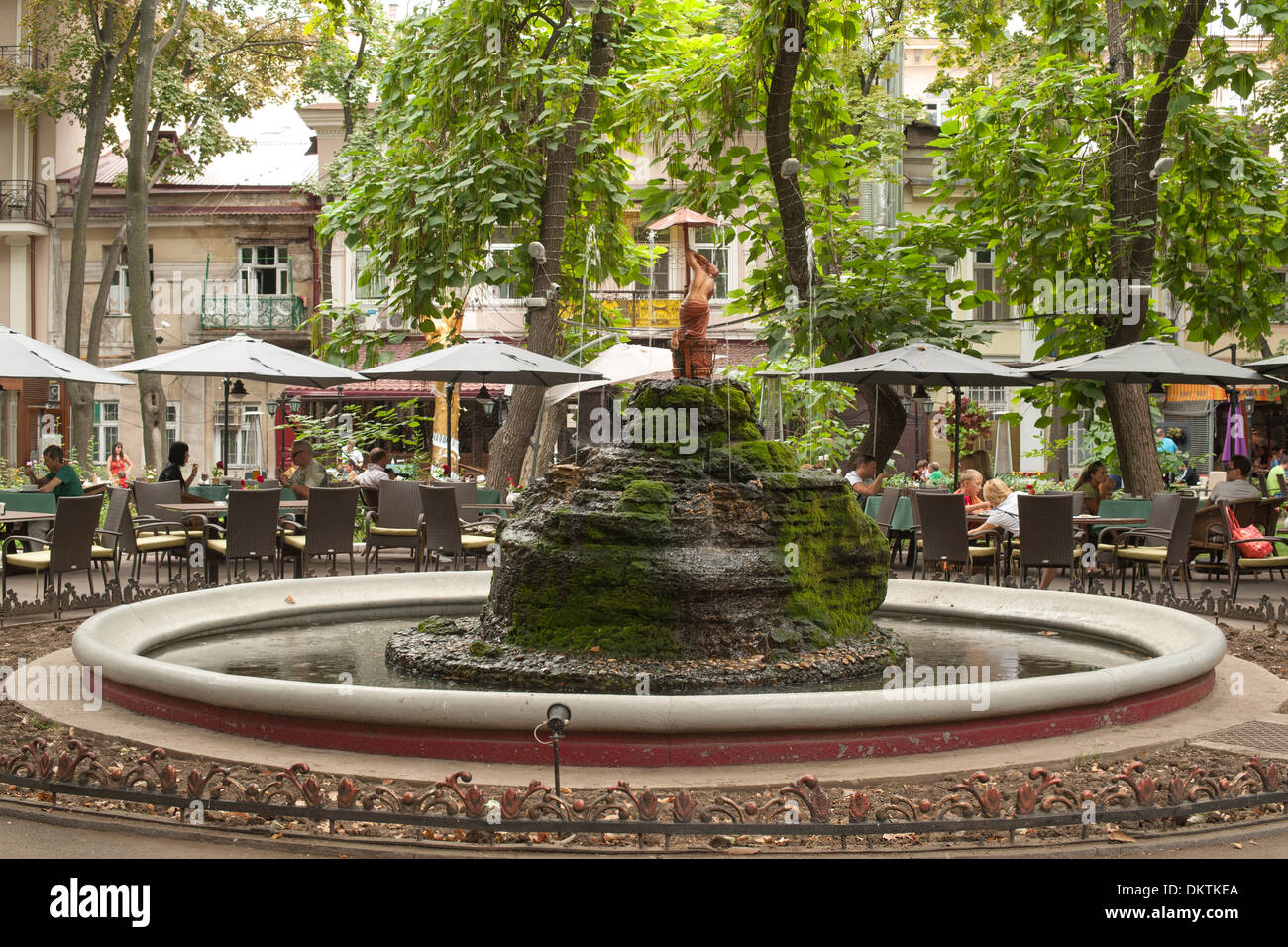 Fountain and restaurant tables in the Palais Royal Garden in Odessa ...