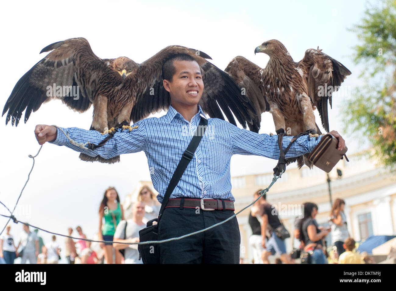 Tourist being photographed with eagles on the Potemkin Stairs in Odessa, Ukraine. - Stock Image