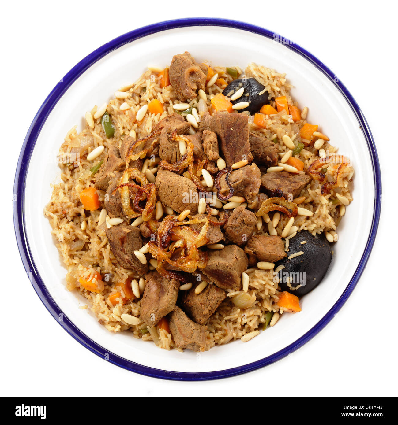 A tagine bowl of Saudi Arabian-style kabsa shot from above, A tomato salsa would be served with this. - Stock Image