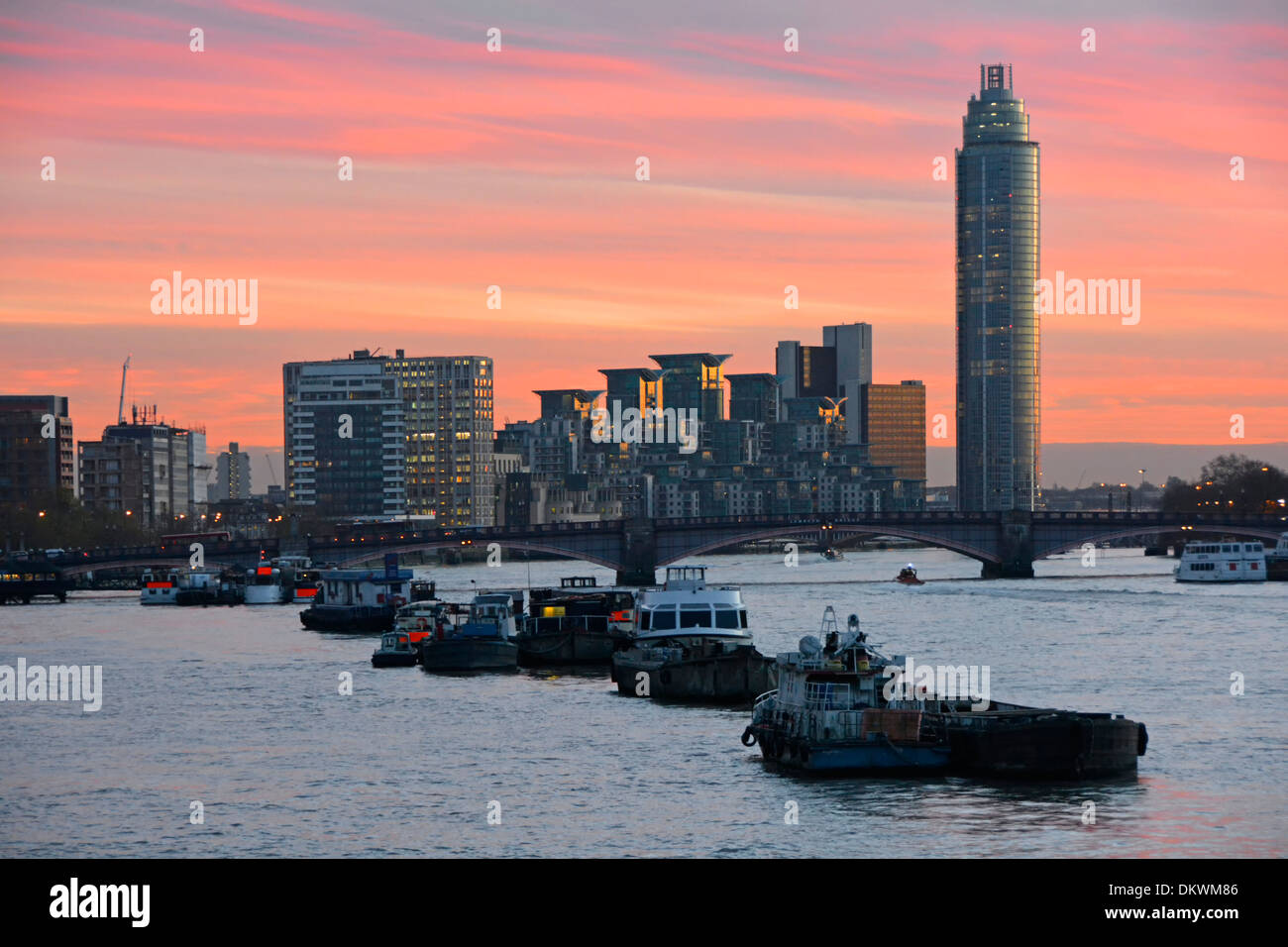 River Thames and sunset looking towards Vauxhall Bridge from Westminster with St George Wharf Tower - Stock Image