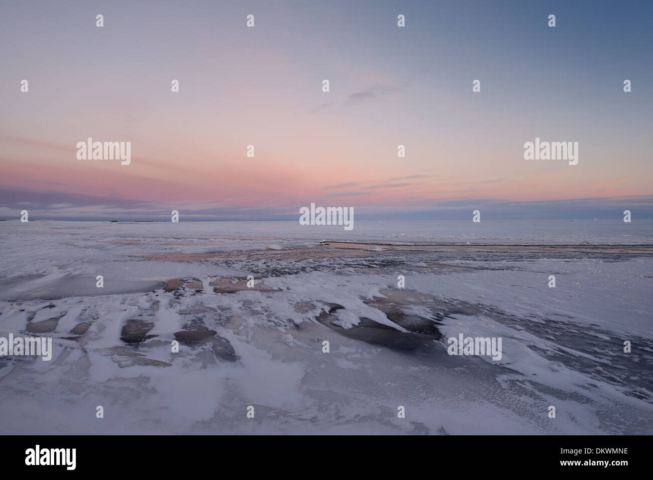 Dusk on the Sag river with distant oil wells at Deadhorse Prudhoe Bay Beaufort Sea Arctic Ocean Alaska USA - Stock Image