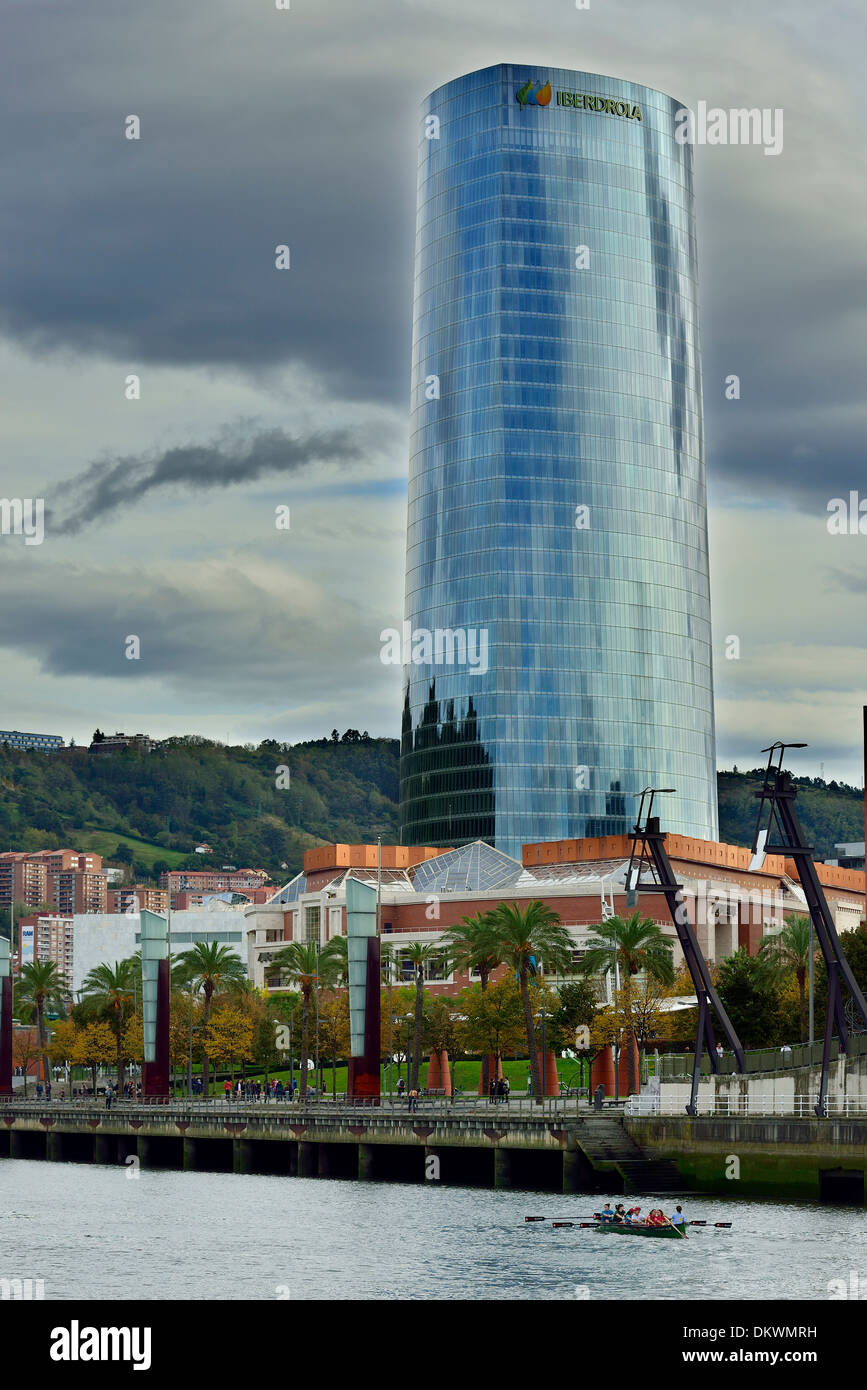 Drifter on the Nervion River and Iberdrola Tower, Bilbao, Biscay, Basque Country, Spain, Europe - Stock Image