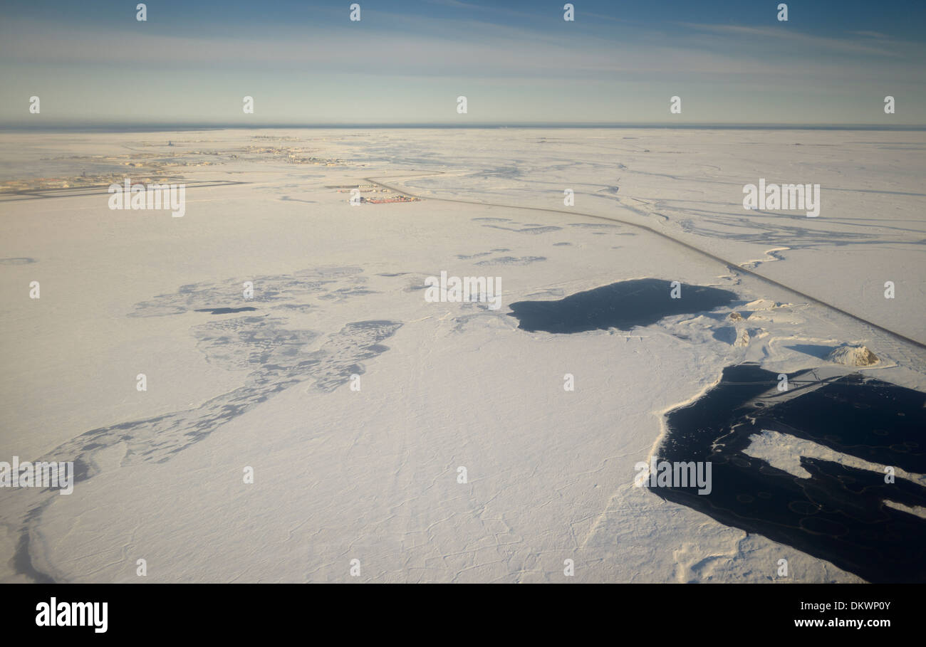 Aerial view of snow covered Deadhorse Alaska USA and the Sag river at Prudhoe Bay Beaufort Sea Arctic Ocean - Stock Image