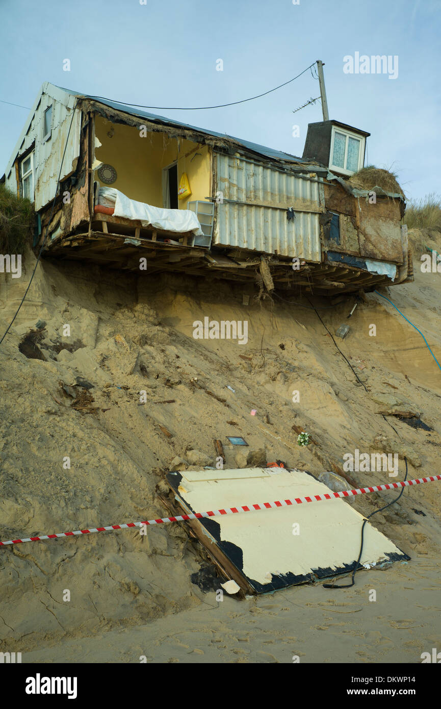 Sea erosion to cliffs at Hemsby Norfolk, England cause bungalow homes to smash into the sea after a tidal surge and gales. - Stock Image