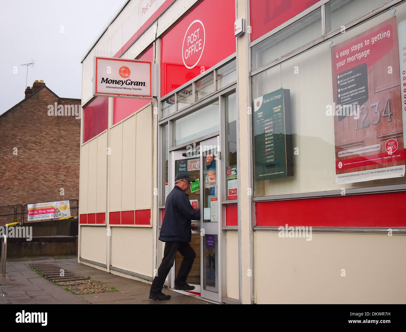 man entering a suburban postoffice in North End Portsmouth - Stock Image