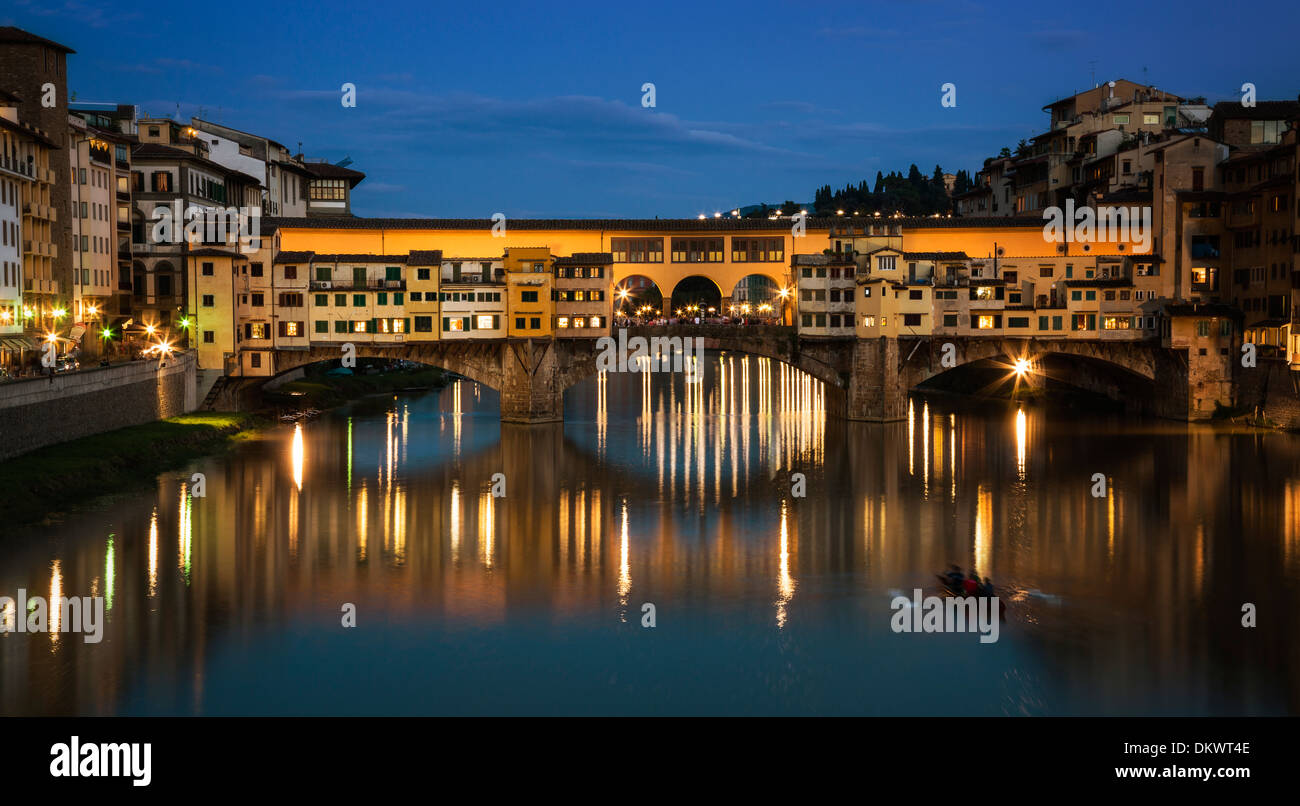 The Ponte Vecchio in Florence, Italy, at dusk. - Stock Image