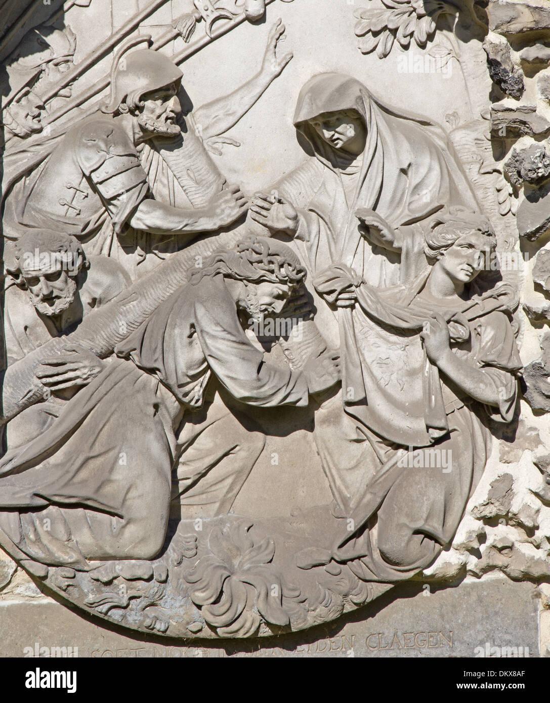 ANTWERP, BELGIUM - SEPTEMBER 5: Stone relief of Jesus fall under the cross from calvary beside St. Pauls church (Paulskerk) - Stock Image