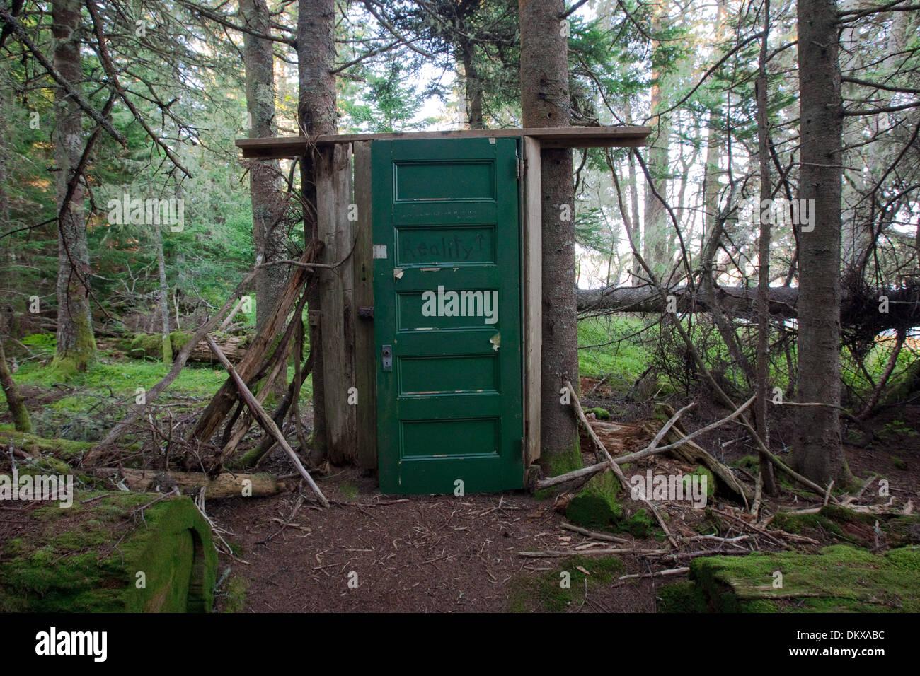 Green Door in the Forest, Buckle Island, Maine - Stock Image