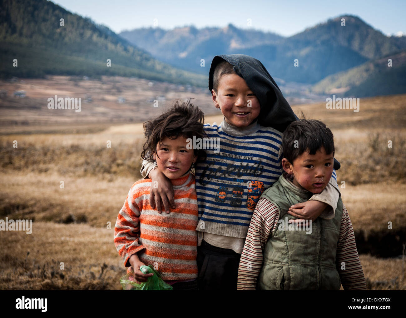 Bhutanese Children playing in the Phobjikha Valley, Bhutan - Stock Image
