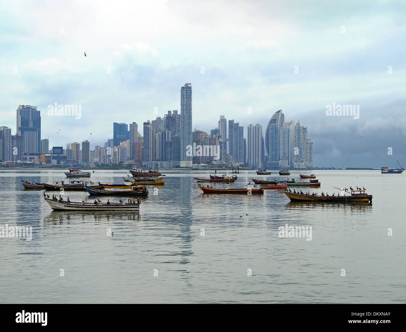 Fishing boats anchored and skyscrapers in background, Panama City , Panama, Central America - Stock Image